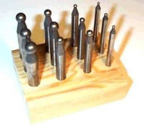 Doming Punches (12) in wooden block